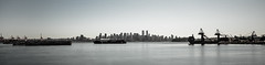 Burrard Inlet Panoramic (Kuelker Photography) Tags: ocean city longexposure sea blackandwhite panorama canada water vancouver port coast boat nikon downtown apartments ship bc skyscrapers pacific britishcolumbia towers shoreline vessel panoramic cranes uptown shore transportation inlet burrardinlet coastline burrard northvancouver condos nikkor shipping westcoast coalharbour offices waterway greyscale 1024mm d5100 kuelker kuelkerphotography