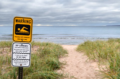 Warning sign, dangerous currents (michiganseagrant) Tags: shoreline dangerouscurrents beachsafety michiganseagrant