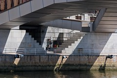 The River Bank - DSC_0423 (Khaled Galal) Tags: bridge people abstract metal stone architecture stairs composition river grey spain stones steel steps bank bilbao stairway guggenheim cantabria floodlights