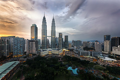 Burning With Pride (Mabmy) Tags: city sunset sky sun tower skyline bar canon landscape evening cityscape view petronas twin sigma malaysia kualalumpur 12mm scape sigma1224mm 1224mm twintower skybar 1dx canon1dx