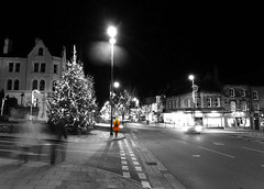 Girl in a red coat (tubblesnap) Tags: christmas white motion black blur colour tree grove leeds spot ilkley selective