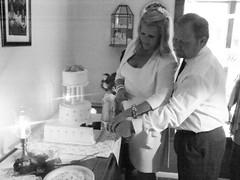 Bride & Groom Cutting Wedding Cake (RevDebbie) Tags: wedding cake groom bride blackwhite weddingcake marriage husband reception wife bridegroom newlyweds weddingreception matrimony wedlock husbandwife homewedding holymatrimony flickrandroidapp:filter=none holywedlock