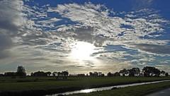 Atmosphere (Eduard van Bergen) Tags: light water clouds landscape licht weide bomen horizon wolken atmosphere land lucht zon landschap luchten
