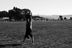 Handstands with the view of the bay (matthewzumwalt) Tags: sanfrancisco people blackandwhite bw handstand mattz