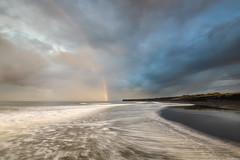 Landfall (Nick Twyford) Tags: longexposure newzealand seascape weather clouds sunrise rainbow waves wideangle nz northisland westcoast wanganui taranaki earlymorninglight moodyclouds colourimage patea leefilters nikond800 manabay lee09nd lee06gndhard phottixgeoone nikkor160350mmf40