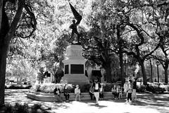 History lesson (halifaxlight) Tags: trees bw monument georgia unitedstates flag group figure historical savannah guide historicdistrict