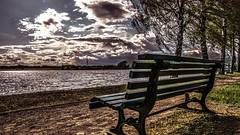 sit down please (bocero1977) Tags: trees light sunset sky sun lake reflection green nature water colors grass clouds germany bench way landscape wooden nikon sundown outdoor path fineart hdr