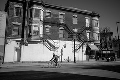 University Biking (patrickkuhl) Tags: street people blackandwhite monochrome bike bicycle wisconsin blackwhite university shadows 28mm streetphotography madison biking gr madisonwi avenue ricoh ricohgr wisco wisc