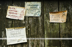 Hobbiton, New Zealand (Naomi Rahim (thanks for 2 million hits)) Tags: newzealand nz 2016 northisland hobbiton travelphotography travel hobbitonmovieset lotr lordoftherings nikon nikond7000 wanderlust sign notes noticeboard timber prop movie lettering calligraphy old vintage ads decay