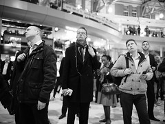 "London Black and White Street Photography - ""The Great Londoners"" (Nicholas Goodden) Tags: people monochrome train waiting candid voigtlander streetphotography olympus rushhour shotfromthehip manualfocus patience blackandwhitephotography waterloostation sadface urbanphotography londoners peopleonthestreets manuallens blackandwhitestreetphotography londonphotography microfourthirds huffingpuffing omdem1"