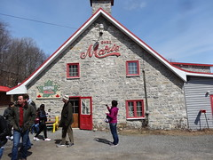 Quebec. Chez Marie. Maple products. Along the Royal Route from Quebec to Sainte Anne de Beaupre. (denisbin) Tags: roof house river pond quebec cottage icy maplesyrup frenchstyle adamsfamily saintlawrence chezmarie royalroad avenueroyale icypond frenchroof produitsderable