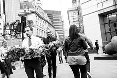 Cerimonial flowers (lorenzoviolone) Tags: england people blackandwhite bw london monochrome blackwhite unitedkingdom strangers streetphotography finepix fujifilm streetphoto transporting flowersplants mirrorless vsco streetphotobw vscofilm fujix100s x100s fujifilmx100s travel:uk=londonapr16