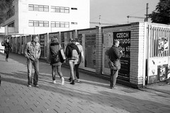 Minolta Hi-Matic G - Man Looking at Women (Kojotisko) Tags: bw streetphotography brno creativecommons czechrepublic streetphoto vx400 konicamonochromevx400 minoltahimaticg konicamonochrome