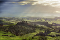 Rays of light through the clouds (Agrippino Salerno) Tags: morning trees light shadow sky italy green colors misty fog clouds farmhouse sunrise canon countryside hills tuscany cypress siena rays valdorcia sanquiricodorcia poderebelvedere agrippinosalerno