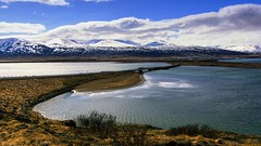 the beauty of fjord crossings (lunaryuna) Tags: sky panorama nature water beauty clouds reflections season landscape coast iceland spring solitude textures fjord lowtide lunaryuna stillness cloudscape mountainrange bridgingthegap boggrass northiceland seasonalchange lightmood northfjords thecoloursoficeland