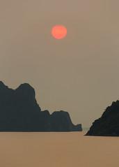 Hazy Halong Bay Sunset (Rob Kroenert) Tags: ocean cruise sunset sun water evening bay boat wings haze asia long gray royal orb cliffs vietnam viet limestone ha southeast hazy halong nam