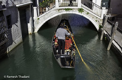 Gondolier (Ramesh_Thadani) Tags: bridge venice italy boat canal transport it oar gondola venezia touristattraction attraction gondolier historiccity veneto rowingboat historiccenter gondoleiro historiccentre venetianrowingboat callevaincampo riodesananzolo