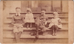 Step children (c.1880s) (pellethepoet) Tags: boys girl kids children shoes boots brothers unitedkingdom outdoor sister steps siblings photograph cdv cartedevisite groupportrait pinafore