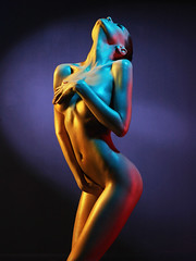 Elegant nude model in the light colored spotlights (George Mayer) Tags: blue light red portrait woman black hot color sexy art beautiful beauty yellow lady female pose studio naked nude cool intense mixed model perfect colorful paint neon shine slim skin artistic body expression feminine background gorgeous creative young posing sensual filter figure sensuality shape bodyart effect seductive cosmic futuristic elegance