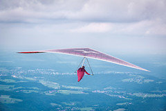 Hang glider heading for Chiemsee (Geolilli) Tags: travel trees lake man alps tourism sports sport canon germany landscape bavaria helmet gliding glider hang chiemsee humans 70d ruhpolding