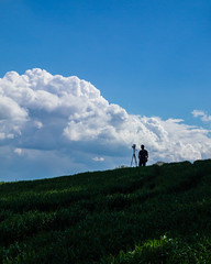Cloud hunter (The Adventurous Eye) Tags: camera blue sky clouds horizon moment capture operator