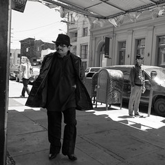 we're all free agents of a substance or scale (Super G) Tags: sanfrancisco blackandwhite bw man men sunglasses walking square candid hats streetphotography agents