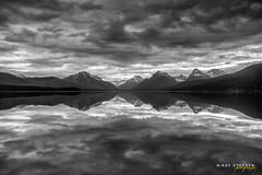 The Tempest (djniks) Tags: lake mountains reflection clouds still montana horizon stormy glaciernationalpark silverlining silverline gnp canon1740f4 canon5dmkii