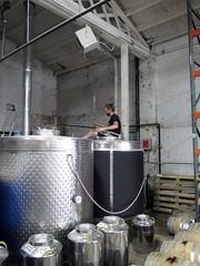 Dude stirring a vat at Few Distillery in Chicago (benchilada) Tags: chicago dude few vat distillery stirring