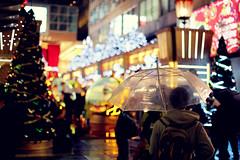 Rainy Day ([~Bryan~]) Tags: christmas city light wet rain umbrella season hongkong rainyday bokeh harbour raining greeting tst