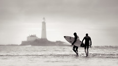 Surfers at Old Hartley (Alistair Bennett) Tags: lighthouse sunrise mono northsea surfers stmarys whitleybay tynewear oldhartley canonef70200mm28lisiiusm