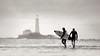 Surfers at Old Hartley (Alistair Bennett) Tags: lighthouse sunrise mono northsea surfers stmarys whitleybay tynewear oldhartley canonef70200mmƒ28lisiiusm