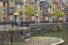 Modern canal side apartments at Discovery Walk next to Tobacco Dock, Wapping, London UK (Roberto Herrett) Tags: new uk trees houses homes england streets london geometric water colors k horizontal architecture modern docks buildings real colorful apartments colours estate waterfront unitedkingdom patterns bricks property facades architectural canals flats walkway u wharf porch housing colored docklands blocks paths colourful residence accommodation expensive residential footpath coloured properties developments stockphoto dwellings exteriors prestigious rherrettflk