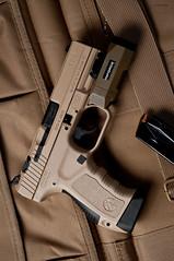 _DSC2130 (Staufhammer) Tags: light black magazine photography 50mm nikon gun desert tan weapon pistol guns handgun clone product copy weapons firearm firearms walther apl d300 18d p99 nikon50mmf18d inforce fde tp9 nikond300 canik canik55 staufhammer