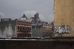 Dripping Architecture (lefeber) Tags: city windows urban newyork rooftop rain architecture buildings graffiti harlem urbandecay rainy