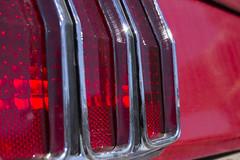 Mustang Tail Light (taraschmidtphotog) Tags: light red ford crimson car bright tail rear brake mustang