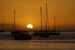Quand le soleil joue  cache-cache avec les nuages (! Nature Bx !) Tags: sunset sea sun mer nature landscape soleil boat sony bateau paysage coucherdesoleil guadeloupe carabes deshaies lesantilles dsc06190