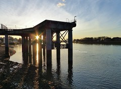 Disused pier (Steve Denny) Tags: sunset sky sun london water silhouette clouds shadows panasonic sunrays riverthames hdr dmctz35 project2015
