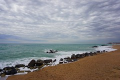 Moody skies in Costa Brava (venesha83) Tags: barcelona sea sky beach clouds rocks overcast costabrava santasusanna
