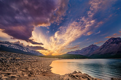 Sunset in the Canadian Rockies (Tracy Munson Photography) Tags: travel sunset sky lake canada mountains tourism nature clouds landscape nationalpark ab alberta banff rockymountains peaks banffnationalpark parkscanada lakeminnewanka therockies