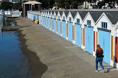 Red Head By Boat Sheds (mikecogh) Tags: woman doors waterfront redhead edge repetition wellington headphones boatsheds