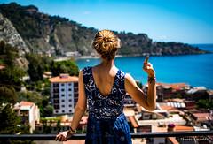Enjoying the view of Giardini Naxos, Sicily (ThomasBartelds) Tags: italy woman girl view middlefinger fuckyou sicily