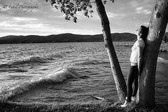 The Girl by the Lake. (fabriziobelia) Tags: sunset blackandwhite bw italy woman lake love nature girl canon umbria biancoenero trasimeno lagotrasimeno canoneos600d