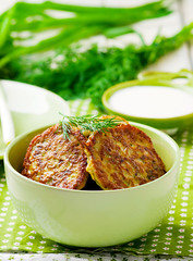 vegetable marrows fritters with sour cream on a green plate. (Zoryanchik) Tags: food cooking apple cheese pancakes dinner recipe lunch cuisine golden potatoes dish background cottage plate vegetable crispy snack meal vegetarian onion pancake marrows fried patties fritters prepared fritter