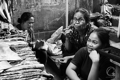 The Bite (Carbonell Icon) Tags: street portrait people blackandwhite bw bali woman girl face female contrast canon indonesia photography photo eyes flickr bokeh streetphotography expressive environment ubud 2015 canon5dmiii 5dmiii
