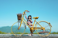 Yellow Bicycle and Little Girl ( aikawake) Tags: blue sky baby cute art beauty station weather bike bicycle yellow train wonderful children landscape countryside kid spring scenery tour child ride good indigo sunny glorious  magichour   peole