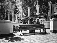 A Place With A View (TMimages PDX) Tags: street plaza city people urban blackandwhite monochrome buildings square portland geotagged photography photo image streetphotography streetscene sidewalk photograph pedestrians pacificnorthwest vignette fineartphotography iphoneography