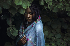 Roots grew so far (Enrico Cavallarin) Tags: light wild portrait woman green girl leaves forest scarf 50mm eyes darkness skin hidden portraiture scare ritratto blackgirl intothewild