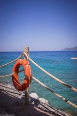 Lifebuoy (aleksey_kondratiev) Tags: turkey fethiye oludeniz mediterranean sea water blue wave waves seashore rocks sky