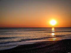 Soleil couchant (vostok 91) Tags: ocean sunset sun mer soleil eau fujifilm plage reflets couchant fujix20 vostok91