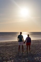 Turn Your Eyes To The Heavens (peetey897) Tags: ocean sun moon beach couple long exposure